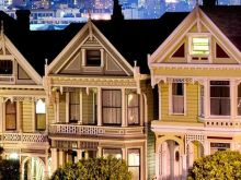 Close up of the Painted Ladies in Alamo Square at night.