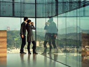 Man and woman inside the de Young museum