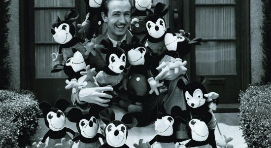 Walt surrounded by Mickey dolls.JPG